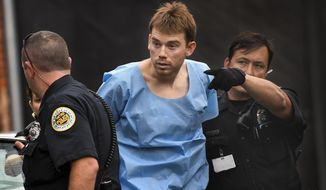 In this Monday, April 23, 2018 photo, Travis Reinking, suspected of killing four people in a late-night shooting at a Waffle House restaurant, is escorted into the Hill Detention Center in Nashville, Tenn., Monday, April 23, 2018. (Lacy Atkins/The Tennessean via AP)