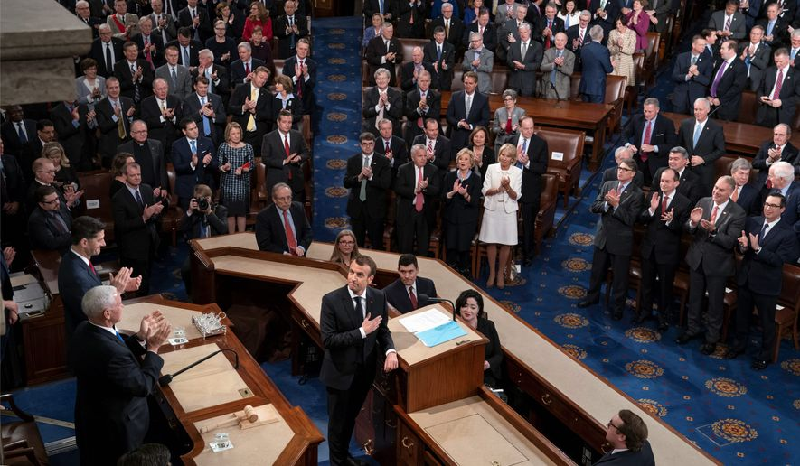 French President Emmanuel Macron turned to Vice President Mike Pence and House Speaker Paul D. Ryan and touched his hand to his heart as he finished his address Wednesday to a joint meeting of Congress. Most of the applause came from Democrats. (Associated Press)