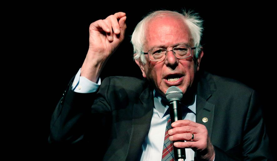 In this April 4, 2018 photo, Sen. Bernie Sanders, I-Vt., speaks on a question during a town hall meeting with Jackson Mayor Chokwe Antar Lumumba, examining economic justice 50 years after the assassination of Dr. Martin Luther King Jr., in Jackson, Miss. (AP Photo/Rogelio V. Solis)