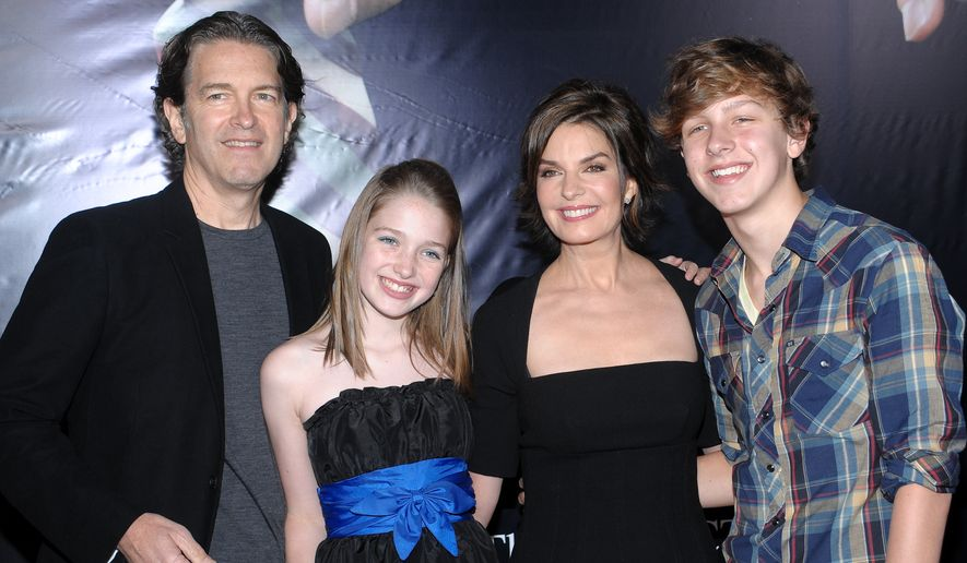 From left, Howard Sherman, Annabella Sherman, Sela Ward and Austin Sherman attend the premiere of 'The Stepfather' at the School of Visual Arts Theater on Monday, Oct. 12, 2009 in New York. (AP Photo/Evan Agostini)