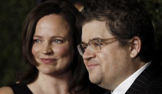 """Cast member Patton Oswalt, right, and Michelle Eileen McNamara arrive at the premiere of """"Young Adult"""" in Beverly Hills, Calif., Thursday, Dec. 15, 2011. """"Young Adult"""" opens wide in theaters Dec. 16, 2011. (AP Photo/Matt Sayles)"""
