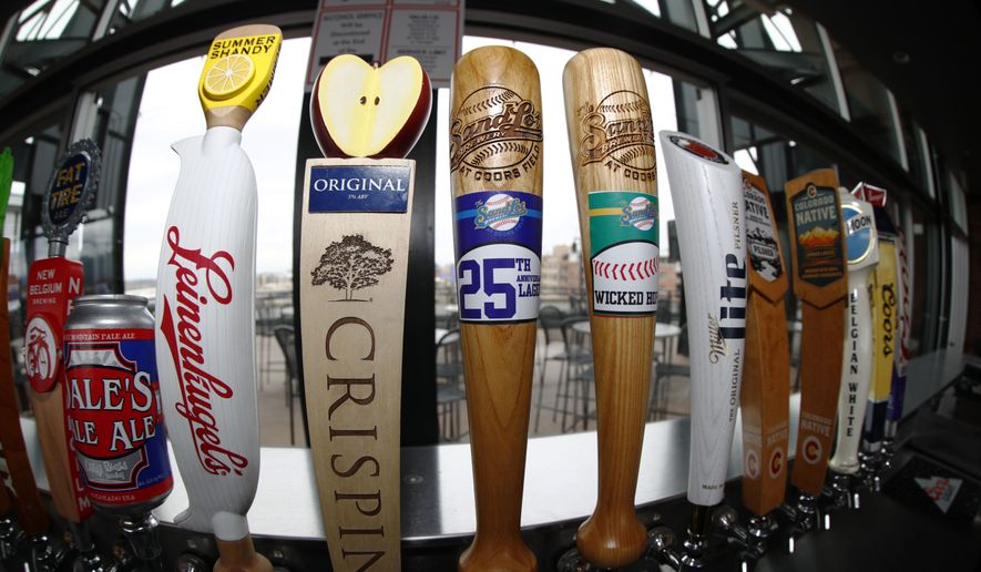 As viewed through a fisheye lens, beer taps line the rooftop bar in right field in Coors Field as preparations continue for the Colorado Rockies' regular-season home opener Thursday, April 5, 2018, in Denver. (AP Photo/David Zalubowski) ** FILE **