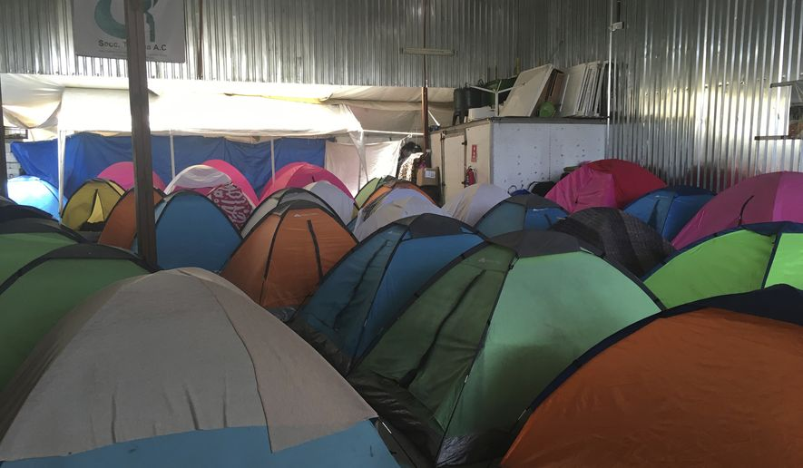 """Temporary tents for about 130 Central Americans, mostly women and children, who arrived at the U.S. border with Mexico in a """"caravan"""" of asylum-seeking immigrants that has drawn the fury of President Donald Trump, are seen in a shelter in Tijuana, Mexico, on Tuesday, April 24, 2018. Two busloads arrived late Tuesday, in the Mexican border city of Tijuana, and another 200 were expected to come. Legal workshops are planned later this week and the first large group is expected to try to enter the United States on Sunday at a border crossing in San Diego. in San Diego, Calif. (AP Photo/Elliot Spagat)"""