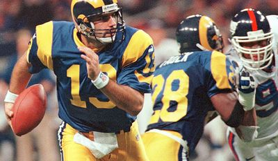 Kur Warner QB St. Louis Rams. He was originally signed by the Green Bay Packers as an undrafted free agent in 1994 after playing college football at Northern Iowa. He played for the Rams from 1998 to 2003, where he won NFL MVP awards in 1999 and 2001 as well as the Super Bowl MVP award in Super Bowl XXXIV when he and the Rams beat the Tennessee Titans. In 13 career playoff games, Warner ranks 5th all-time in completion percentage (66.5%), 10th in yards per attempt (8.55), and 10th in passer rating (102.8). Warner was inducted into the Pro Football Hall of Fame in 2017, and is the only person inducted into both the Pro Football Hall of Fame and the Arena Football Hall of Fame. (AP Photo/Tom Gannam)