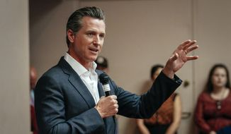 California gubernatorial candidate Gavin Newsom speaks with residents during a packed meet and greet in the San Luis Obispo, Calif., Wednesday, April 25, 2018.  (Joe Johnston/The Tribune (of San Luis Obispo) via AP)