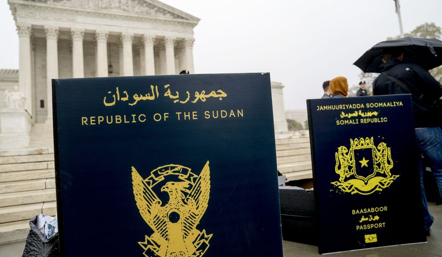 Poster sized enlargements of passports are on display during an anti-Muslim ban rally as the Supreme Court hears arguments about wether President Donald Trump's ban on travelers from several mostly Muslim countries violates immigration law or the Constitution, Wednesday, April 25, 2018, in Washington. (AP Photo/Andrew Harnik)