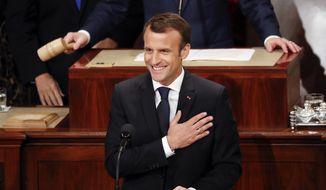 French President Emmanuel Macron puts his hand over his chest during his address to a joint meeting of Congress on Capitol Hill in Washington, Wednesday, April 25, 2018. (AP Photo/Pablo Martinez Monsivais)