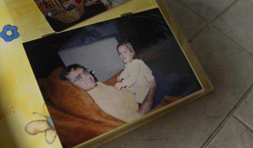 This Wednesday, Jan. 10, 2018, photo shows a family picture of Andrea Chancey and her father, in Biloxi, Miss., taken during her childhood. Chancey's parents were killed when the transcontinental train the family was on, tumbled off a bridge into a south Alabama bayou, in 1993. (AP Photo/Brynn Anderson)