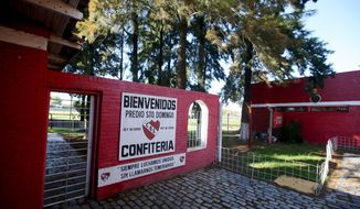 This April 14, 2018 photo, shows the entrance to the Independiente soccer club's training headquarters, in a suburb of Buenos Aires, Argentina. Independiente filed a complaint with prosecutors earlier this year when the allegations first surfaced about child abuse at the club, after one of the players broke down during a session with a club psychologist. (AP Photo/Luciano Matteazzi)