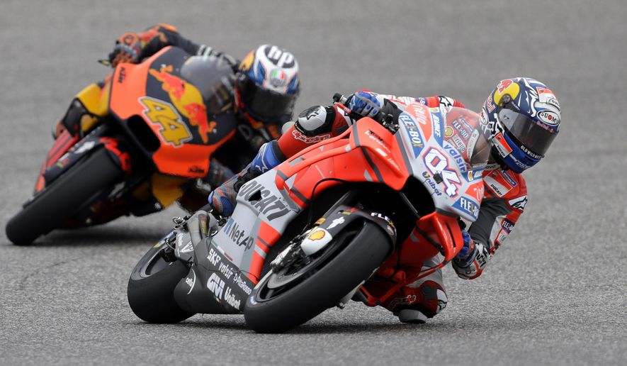 Andrea Dovizioso (4), of Italy, leads Pol Espargaro (44), of Spain, through a turn during a free practice for the Grand Prix of the Americas motorcycle race at the Circuit Of The Americas in Austin, Texas, Saturday, April 21, 2018. (AP Photo/Eric Gay)