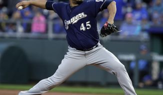 Milwaukee Brewers starting pitcher Jhoulys Chacin deliver to a Kansas City Royals batter during the first inning of a baseball game at Kauffman Stadium in Kansas City, Mo., Wednesday, April 25, 2018. (AP Photo/Orlin Wagner)