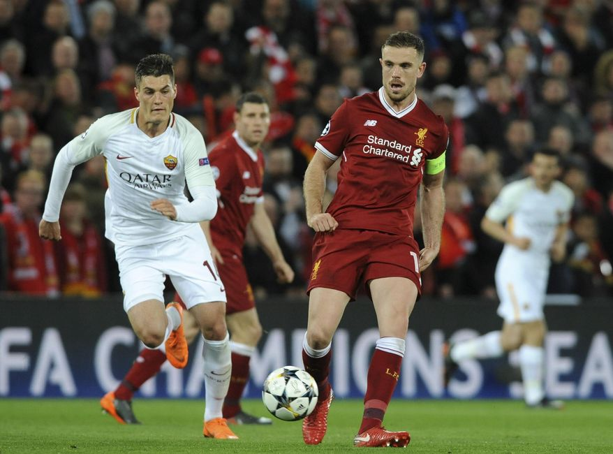 Liverpool's Jordan Henderson, right, duels for the ball with Roma's Patrik Schick during the Champions League semifinal, first leg, soccer match between Liverpool and Roma at Anfield Stadium, Liverpool, England, Tuesday, April 24, 2018. (AP Photo/Rui Vieira)