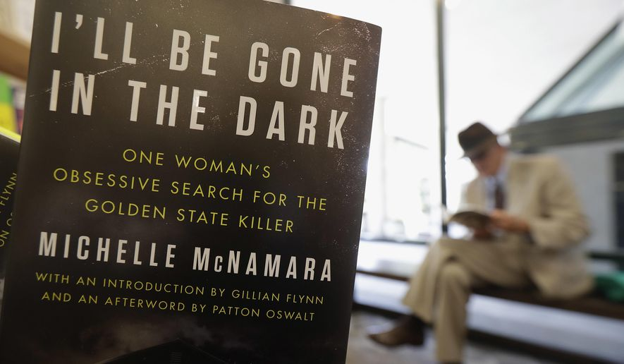 "This Wednesday, April 25, 2018 photo shows a copy of the book ""I'll Be Gone in the Dark: One Woman's Obsessive Search for the Golden State Killer"" by Michelle McNamara at a Books Inc. bookstore in San Francisco. California authorities say a man they suspect of being a serial killer tied to dozens of slayings and sexual assaults in the 1970s and '80s has been charged with murder. (AP Photo/Jeff Chiu)"
