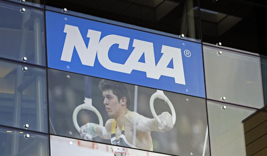 The NCAA headquarters is pictured, Wednesday, April 25, 2018, in Indianapolis. The Commission on College Basketball led by Former U.S. Secretary of State Condoleezza Rice, released a detailed 60-page report Wednesday, seven months after the NCAA formed the group to respond to a federal corruption investigation that rocked college basketball. (AP Photo/Darron Cummings)
