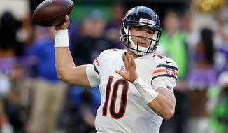 FILE - In this Dec. 31, 2017, file photo, Chicago Bears quarterback Mitchell Trubisky throws a pass during the first half of an NFL football game against the Minnesota Vikings in Minneapolis. The Bears have spent the offseason adding pieces to help Trubisky develop into the franchise quarterback they believe he can become. (AP Photo/Jim Mone, File)