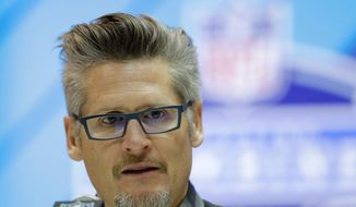 FILE - In this Feb. 28, 2018, file photo, Atlanta Falcons general manager Thomas Dimitroff speaks during a press conference at the NFL football scouting combine, in Indianapolis. The Falcons have the 26th pick of the first round at the NFL Draft. (AP Photo/Darron Cummings, File)