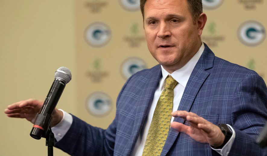 FILE - In this Jan. 8, 2018, file photo, New Green Bay Packers NFL football team general manager Brian Gutekunst gestures while speaking at an introductory news conference in Green Bay, Wis. The Packers choose 14th overall in the NFL Draft. (AP Photo/Mike Roemer, File)
