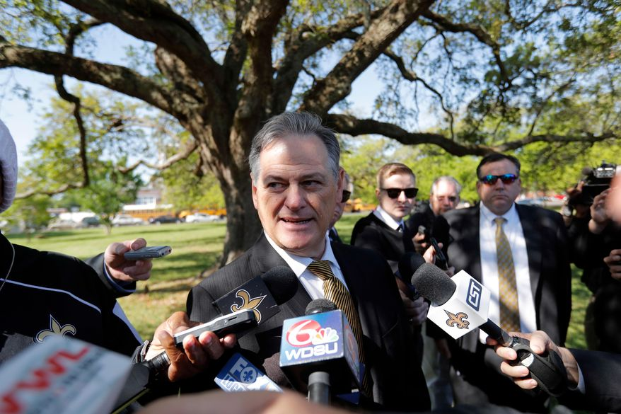 FILE - In this March 21, 2018, file photo, New Orleans Saints general manager Mickey Loomis talks to reporters at the viewing for Tom Benson, at Notre Dame Seminary in New Orleans. Saints general manager Loomis has been around long enough to appreciate the fleeting nature of success in the NFL, particularly as it relates to draft bonanzas and busts. (AP Photo/Gerald Herbert, File)