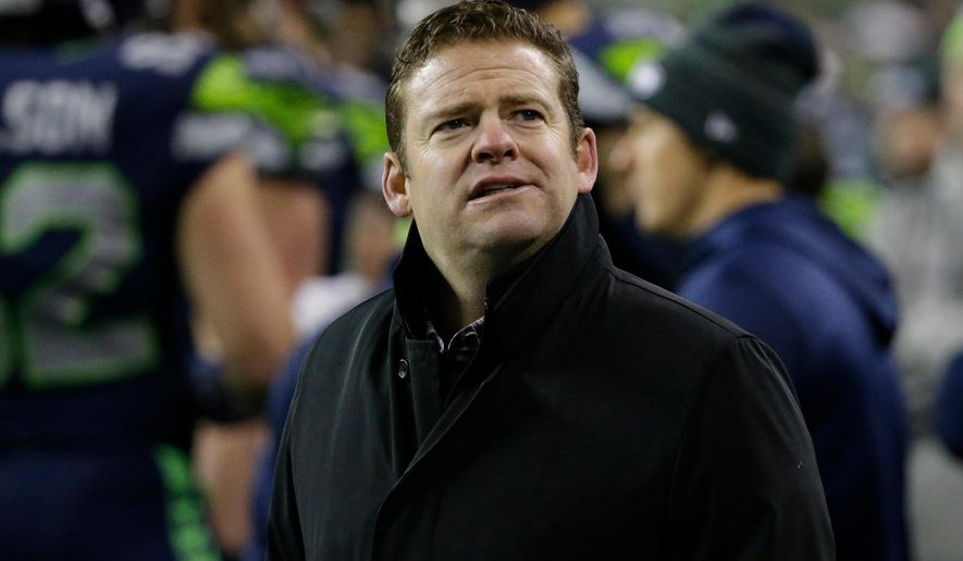 FILE - In this Dec. 3, 2017, file photo, Seattle Seahawks general manager John Schneider stands on the field after an NFL football game against the Philadelphia Eagles,in Seattle. The remodel of the Seahawks has started with the goal of remaining competitive while refreshing a roster that at one time was good enough to win a Super Bowl but grew stale.  The key for Seattle remaining a contender while churning the roster is rediscovering success in the draft after the Seahawks went 9-7 last season and missed the playoffs for the first time since 2011. (AP Photo/Ted S. Warren, File)
