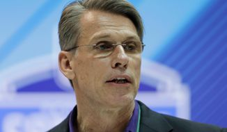 FILE - In this Feb. 28, 2018, file photo, Minnesota Vikings general manager Rick Spielman speaks during a press conference at the NFL football scouting combine, in Indianapolis. The Vikings have the 30th pick in the first round of the NFL Draft. (AP Photo/Darron Cummings, File)