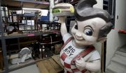 In this Thursday, April 19, 2018 photo, a Big Boy statue from the restaurant chain popular in the 1970s and 1980s and other items sits in the basement of the Wisconsin Historical Society's headquarters in Madison, Wis. Construction of the $46 million State Archive Preservation Facility is complete but now the task of moving artifacts to the facility is underway. The effort is expected to take up to 18 months. (Steve Apps/Wisconsin State Journal via AP)