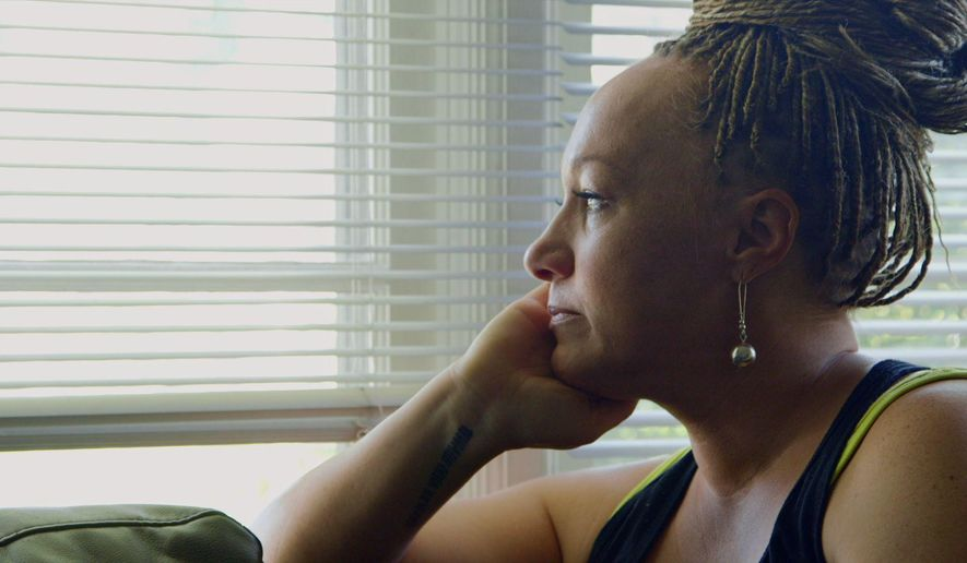 "This image released by Netflix shows Rachel Dolezal in a scene from the documentary ""The Rachel Divide,"" premiering April 27. (Netflix via AP)"