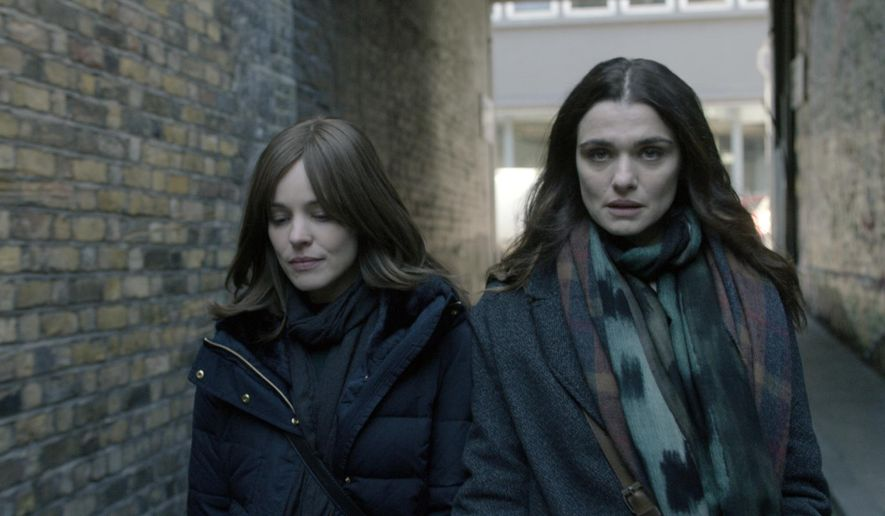 "This image released by Bleecker Street shows Rachel McAdams and Rachel Weisz, right, in a scene from ""Disobedience."" (Bleecker Street via AP)"