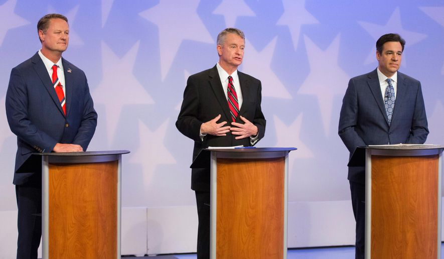 FILE - In this April 23, 2018 file photo Republican Boise businessman Tommy Ahlquist, from left, Lt. Gov. Brad Little and Rep. Raul Labrador, R-Idaho, participate in a debate at the studios of Idaho Public Television in Boise, Idaho. (AP Photo/Otto Kitsinger, File)