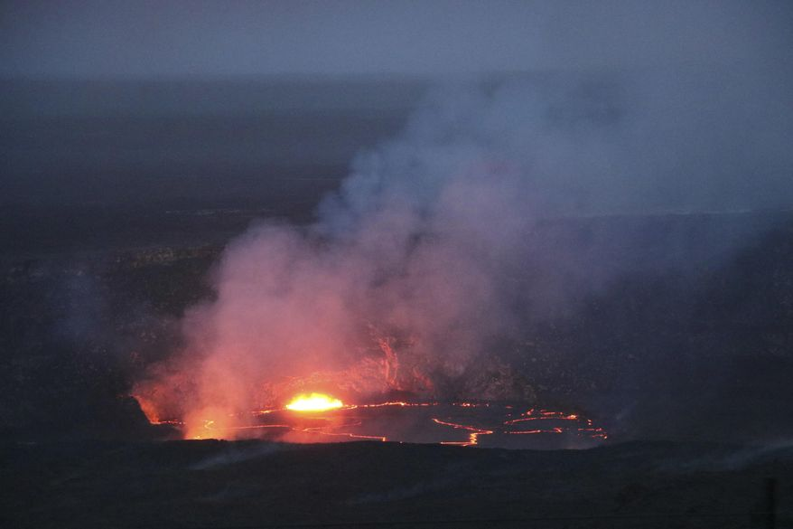 In this April 21, 2018 photo provided by the U.S. Geological Survey, the slowly rising lava lake at Kilauea's summit is shown very close the floor of Halemaumau Crater in Hawaii Volcanoes National Park on Hawaii's Big Island. Lava from Kilauea's summit lava lake continues to overflow intermittently out of its Overlook crater onto the floor of Halemaumau Crater, after recording its largest overflow since the summit vent opened up 10 years ago. Hawaiian Volcano Observatory scientists noted overflows again Wednesday morning around 8:30 a.m., after two episodes of activity Tuesday. (U.S. Geological Survey via AP)