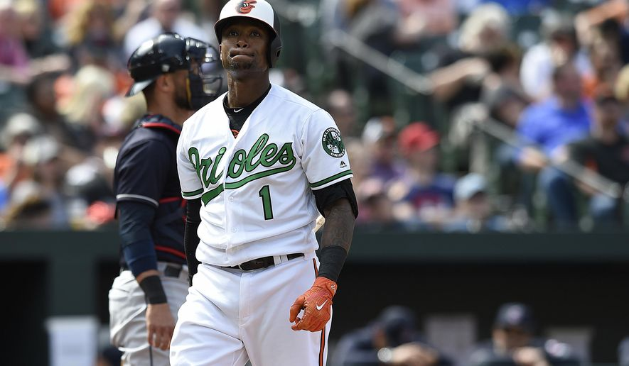 Baltimore Oriole's Tim Beckham reacts after striking out against the Cleveland Indians in the seventh inning of baseball game, Sunday, April 22, 2018, in Baltimore. The Indians won 7-3. (AP Photo/Gail Burton)