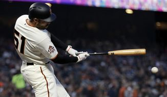 San Francisco Giants' Mac Williamson singles during the second inning of a baseball game against the Washington Nationals Tuesday, April 24, 2018, in San Francisco. (AP Photo/Marcio Jose Sanchez)