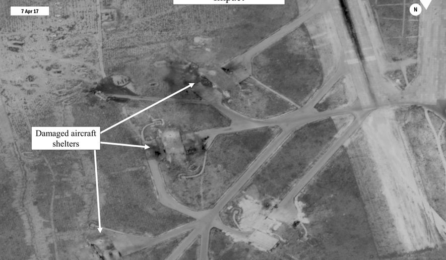 This satellite image released by the U.S. Department of Defense shows a damage assessment image of Shayrat air base in Syria, following U.S. Tomahawk Land Attack Missile strikes on Friday, April 7, 2017 from the USS Ross (DDG 71) and USS Porter (DDG 78), Arleigh Burke-class guided-missile destroyers, in retaliation for a chemical weapons attack against civilians. On Saturday, April 21, 2018, The Associated Press has found that stories circulating on the internet that the Trump Organization won a contract to rebuild the Syrian airport are untrue. (DigitalGlobe/U.S. Department of Defense via AP)