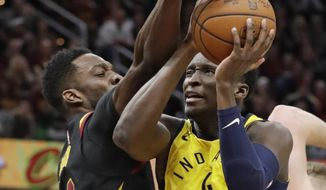 Indiana Pacers' Victor Oladipo, right, drives against Cleveland Cavaliers' Jeff Green in the second half of Game 5 of an NBA basketball first-round playoff series, Wednesday, April 25, 2018, in Cleveland. The Cavaliers won 98-95.(AP Photo/Tony Dejak)