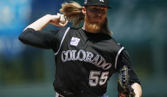 Colorado Rockies starting pitcher Jon Gray delivers a pitch to San Diego Padres' Jose Pirela in the first inning of a baseball game Wednesday, April 25, 2018, in Denver. (AP Photo/David Zalubowski)