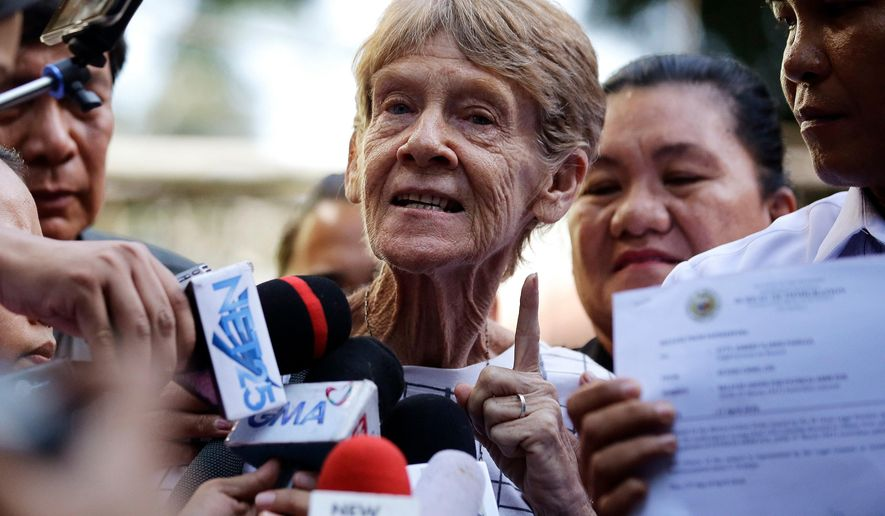 FILE - In this April 17, 2018, file photo, Australian missionary Sister Patricia Fox gestures as she is interviewed by reporters after she was released from custody at the Bureau of Immigration in Manila, Philippines. The Philippines on Wednesday, April 25, 2018 cancelled Fox's missionary visa for engaging in political activity and gave her 30 days to leave the country. (AP Photo/Aaron Favila, File)