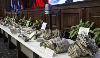 """Fragments of US """"tomahawk"""" cruise missiles captured by Syrian forces in a recent attack, are displayed at a briefing in the Russian Defense Ministry in Moscow, Russia, Wednesday, April 25, 2018. The Russian military has indicated it will supply the Syrian government with a sophisticated air defense system, after condemning a missile attack launched by the U.S., Britain and France earlier this month. (AP Photo/Alexander Zemlianichenko)"""
