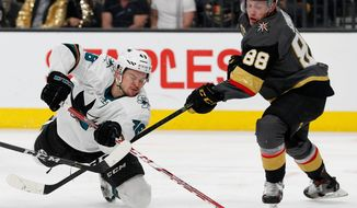 FILE - In this March 31, 2018, file photo, San Jose Sharks center Tomas Hertl (48) vies for the puck with Vegas Golden Knights defenseman Nate Schmidt (88) during the second period of an NHL hockey game, in Las Vegas. It took one trip to Las Vegas early in the season for the San Jose Sharks to realize that the fast start to the season for the expansion Golden Knights was no fluke. So it should come as little surprise to the Sharks that they have to get past Vegas in the second round of the playoffs starting Thursday night, April 26, to reach the Western Conference final for the fourth time in the past nine seasons.(AP Photo/John Locher, File)