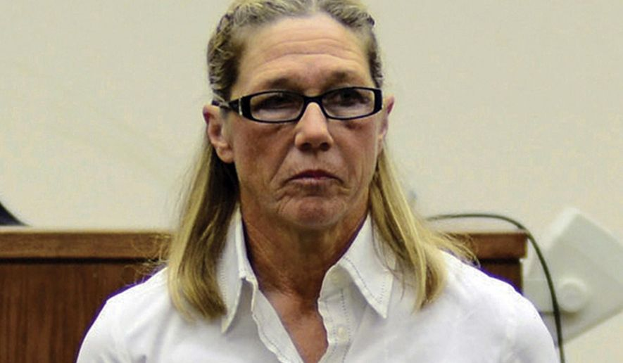 FILE - In this Oct. 22, 2012, file photo, former Dixon, Ill., comptroller Rita Crundwell, leaves a courtroom in Dixon. Crundwell, convicted and serving a 20-year prison sentence after pleading guilty to stealing the money over two decades to support a lavish lifestyle and a nationally renowned horse-breeding operation, has been transferred to the Pekin Federal Correctional Institution in her home state of Illinois. She previously served prison time in Minnesota and at a federal medical center in Texas before her transfer to Pekin in early April 2018. (Alex T. Paschal/TheDaily Gazette via AP, File)