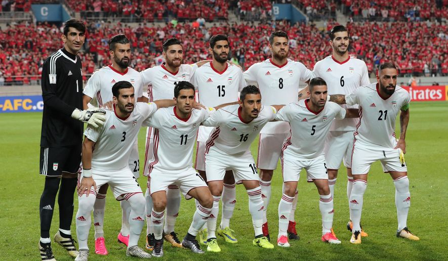 In this photo taken on Thursday, Aug. 31, 2017, Iran's team players, back row from left, Alireza Beiranvand, Ramin Rezaeian, Alireza Jahanbakhsh, Mohammad Ansari, Morteza Pouraliganji, Saeid Ezatolahi and front row from left, Ehsan Hajsafi, Vahid Amiri, Reza Ghoochannejhad, Milad Mohammadi, Ashkan Dejagah pose for the team photo before the 2018 Russia World Cup Group A qualifying soccer match against South Korea at Seoul World Cup Stadium in Seoul, South Korea. (AP Photo/Lee Jin-man)