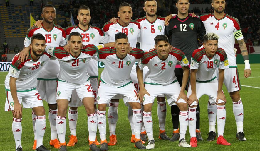 In this photo taken on Tuesday, March 27, 2018, from top left, Morocco soccer players Elkaabi Ayoub, Elhajam Oualid, Bammou Yacine, Saiss Ghanem, Munir Elkajoui, Dacosta Merouane, from bottom left, Labyed Zakaria, Amrabat Soufyan, Fajr Faycal, Hakimi Achraf, Harit Amine pose prior to a friendly soccer match between Morocco and Uzbekistan in Casablanca, Morocco. (AP Photo/Abdeljalil Bounhar)