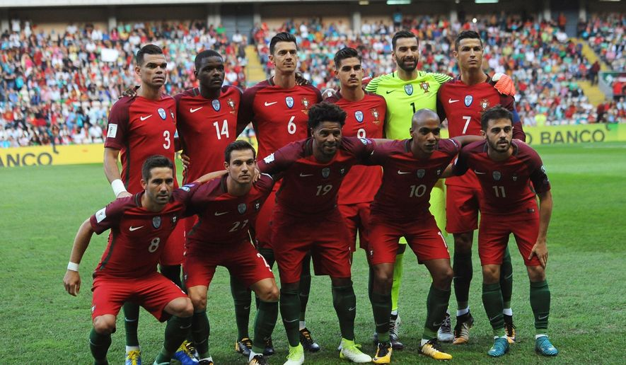 FILE - In this Thursday Aug. 31, 2017 filer Portugal players pose for photos before the World Cup Group B qualifying soccer match between Portugal and Faroe Islands at the Bessa Stadium in Porto, Portugal. (AP Photo/Paulo Duarte, File)
