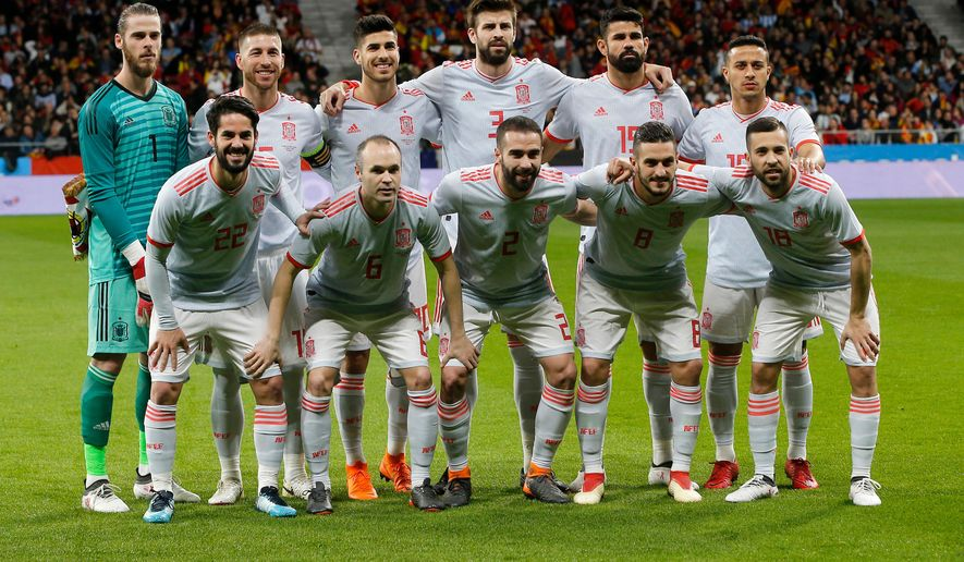 FILE - In this Tuesday, March 27, 2018 file photo, Spain's team poses for a team photo prior the international friendly soccer match between Spain and Argentina at the Wanda Metropolitano stadium in Madrid. (AP Photo/Paul White, File)