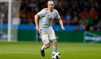 FILE - In this Tuesday, March 27, 2018 file photo, Spain's Andres Iniesta plays the ball during the international friendly soccer match between Spain and Argentina at the Wanda Metropolitano stadium in Madrid. (AP Photo/Francisco Seco, File)
