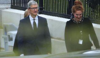 Apple CEO Tim Cook walks to the White House in Washington, Wednesday, April 25, 2018. (AP Photo/Manuel Balce Ceneta)