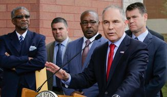 "FILE - In this April 19, 2017, file photo, Environmental Protection Agency Administrator Scott Pruitt speaks at a news conference with Pasquale ""Nino"" Perrotta, second from left, in East Chicago, Ind. Perrotta, the security chief for the head of the Environmental Protection Agency worked on the side as a private investigator for the owner of a tabloid news company with close ties to President Donald Trump. (AP Photo/Teresa Crawford, File)"