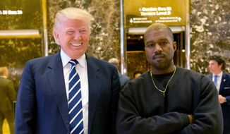 In this Dec. 13, 2016, file photo, then-President-elect Donald Trump and Kanye West pose for a picture in the lobby of Trump Tower in New York. (AP Photo/Seth Wenig, File)