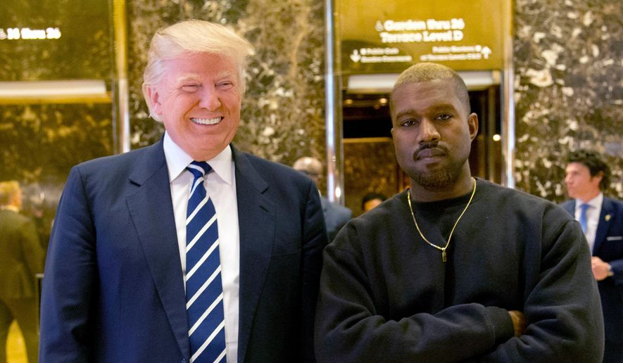 Kanye West poses for a picture in the lobby of Trump Tower in New York with then-President-elect Donald Trump, Dec. 13, 2016. (AP Photo/Seth Wenig) ** FILE **