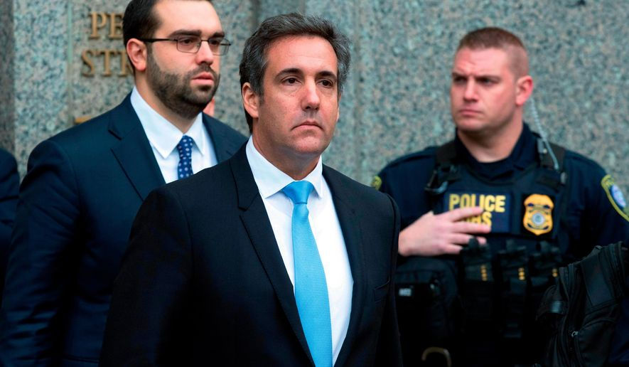 FILE - In a Monday, April 16, 2018, file photo, Michael Cohen, President Donald Trump's personal attorney, center, leaves federal court, in New York. Cohen filed papers in federal court in Los Angeles Wednesday, April 25, 2016, saying he will assert his Fifth Amendment rights, stating that he will exercise his constitutional right against self-incrimination in a lawsuit brought by porn actress Stormy Daniels, who said she had an affair with Trump. (AP Photo/Mary Altaffer, File)
