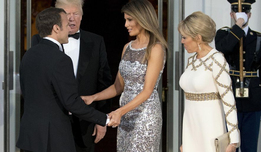 President Donald Trump and first lady Melania Trump greet French President Emmanuel Macron and his wife Brigitte Macron as they arrive for a State Dinner at the White House in Washington, Tuesday, April 24, 2018. (AP Photo/Andrew Harnik)