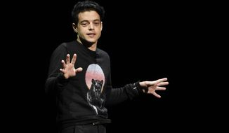"""Rami Malek, who plays the late Queen singer Freddy Mercury in the upcoming film """"Bohemian Rhapsody,"""" discusses the film during the 20th Century Fox presentation at CinemaCon 2018, the official convention of the National Association of Theatre Owners, at Caesars Palace on Thursday, April 26, 2018, in Las Vegas. (Photo by Chris Pizzello/Invision/AP)"""
